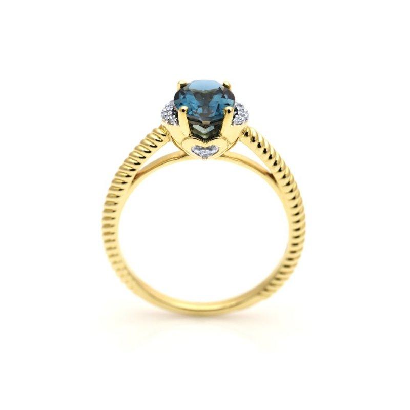 Złoty pierścionek z topazem i diamentami